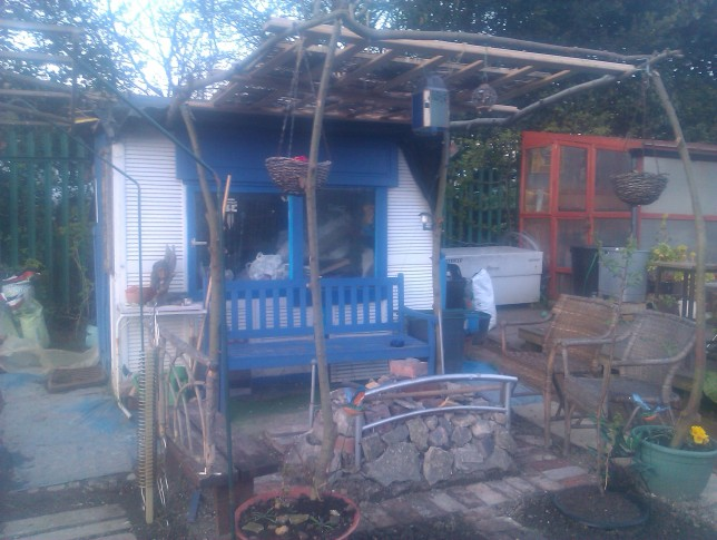 Allotment shed with pergola and barbeque fire-pit - all built from recycled materials